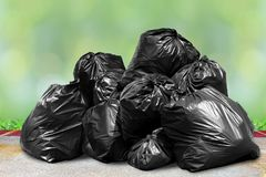 Garbage is pile lots dump, many garbage plastic bags black waste on nature sunshine, pollution from trash plastic waste garbage. The garbage is pile lots dump stock photos