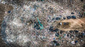 Garbage pile in trash dump or landfill, Aerial view garbage trucks unload garbage to a landfill, global warming.  stock photos