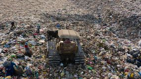 Garbage pile in trash dump or landfill, Aerial view garbage trucks unload garbage to a landfill, global warming.  stock photo