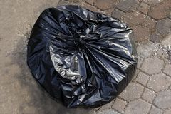Garbage plastic bag black on the cement floor, bag plastic of garbage waste, plastic bag for waste separation recycle, garbage stock photography