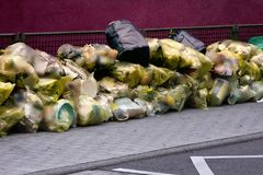 Garbage in plastic bags sorted and ready for transport. Recycling of waste, garbage problem. Garbage in plastic bags sorted and ready for transport royalty free stock photo