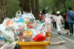 Garbage Plastic Waste Trash Full Of Trash Bin Yellow And Background People Are Walking On The Sidewalk Garden, Garbage Bin, Trash Stock Photography