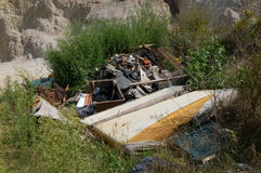 Garbage in quarry Stock Photography