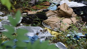 Garbage and ragged clothing stock video footage