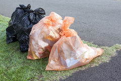 Garbage and Recycling Bags Ready for Collection Stock Photography