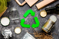 Garbage for recycling with recycling symbol on grey table background top view.  Royalty Free Stock Image
