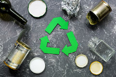 Garbage for recycling with recycling symbol on grey table background top view.  Stock Image