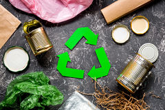 Garbage for recycling with recycling symbol on grey table background top view.  Stock Photo
