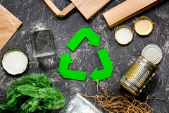 Garbage for recycling with recycling symbol on grey table background top view Stock Photos