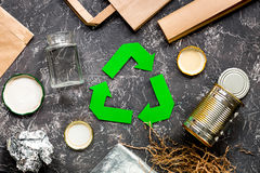 Garbage for recycling with recycling symbol on grey table background top view.  Royalty Free Stock Photo