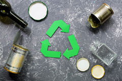 Garbage for recycling with recycling symbol on grey table background top view.  Royalty Free Stock Photos