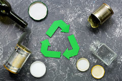 Garbage for recycling with recycling symbol on grey table background top view.  Stock Images
