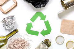 Garbage for recycling with recycling symbol on white background top view Stock Photos