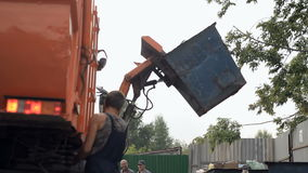 Garbage removal. Garbage truck. Garbage car down the container. stock footage