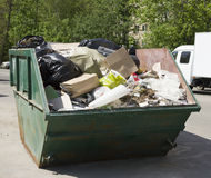 Garbage removal. Green tank with garbage (to the dumpt Stock Photography