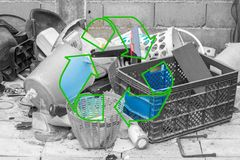 Garbage for reuse. Black and white plastic garbage with stroke green recycle logo on the middle Royalty Free Stock Image