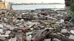 Garbage in river stock video footage