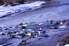 Garbage in the river Stock Images
