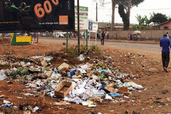 Garbage by the road in Africa. AFRICA,CAMEROON,DSCHANG - JANUARY 23: Heap of garbage beside the road on January, 23, 2013 in Cameroon. Lack of solid waste Stock Image