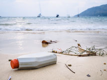 Garbage Rubbish on beach Plastic Bottles Trash Environmental pollution Stock Image