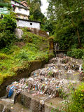 Garbage and rubbish polluting the water in Darjeeling. Garbage and rubbish polluting the water in the slums of Darjeeling in India royalty free stock image