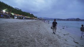 Garbage in the sand after the evening tide on the Dadonghai Beach on the tourist island of Hainan stock video footage