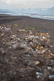Garbage on a sandy polluted beach stock photography
