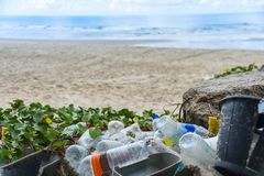 Nvironmental problem of plastic rubbish pollution in ocean. Garbage in the sea with bag plastic bottle and other garbage beach sandy dirty sea on the island / stock photo