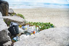 Garbage in the sea with bag plastic bottle and other garbage beach sandy dirty sea on the island - Environmental problem of. Garbage in the sea with bag plastic royalty free stock photography