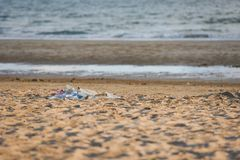 Garbage in the sea with bag plastic bottle and other garbage beach sandy dirty sea on the island / Environmental problem. Of plastic rubbish pollution in ocean royalty free stock images