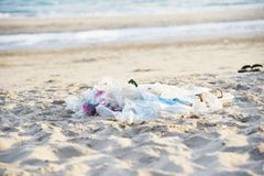 Garbage in the sea with bag plastic bottle and other garbage beach sandy dirty sea on the island / Environmental problem of. Plastic rubbish pollution in ocean stock photo