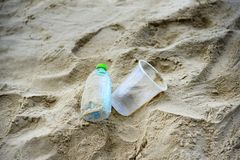 Garbage in the sea with plastic bottle , plastic cup on beach sandy dirty sea on the island - Environmental problem of rubbish stock image