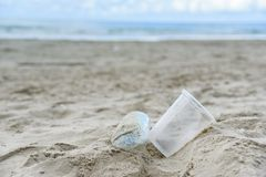 Garbage in the sea with plastic bottle , plastic cup and foam box on beach sandy dirty sea. On the island / Environmental problem of rubbish pollution in ocean stock image