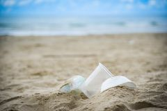 Garbage in the sea with plastic bottle , plastic cup and foam box on beach sandy dirty sea on the island. / Environmental problem of rubbish pollution in ocean royalty free stock images