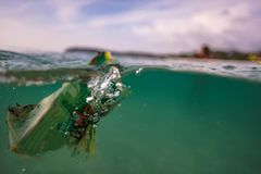 Garbage in sea water near beach royalty free stock images