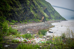 Garbage on the shore of the Sea of Japan. Royalty Free Stock Photos