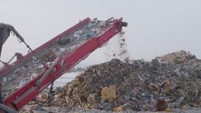 Garbage on shredding line at landfill at winter, Russia. Garbage on shredding line at landfill at winter stock video