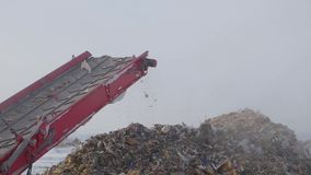 Garbage on shredding line at landfill at winter, Russia. Garbage on shredding line at landfill at winter stock footage