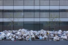 Garbage on a sidewalk. Garbage piled up high on a sidewalk in New York City Stock Image
