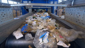 Garbage sorting conveyor on a waste recycling plant. stock video