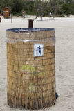 Garbage straws bin on the beach Royalty Free Stock Images
