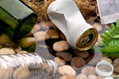 Garbage in a stream:recycle:pollution royalty free stock images