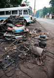 Garbage on the street in Kandy. Garbage, old bus and a lot of trash on the street in Kandy Stock Photo