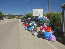 Garbage strike in the greek island Corfu. Pollution and bad smell all around the waste containers. Big stacks og plastik baggs full with garbage. Polution. Bad stock image