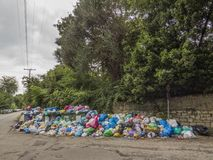 Garbage strike in the greek island Corfu. Pollution and bad smell all around the waste containers. Big stacks og plastik baggs full with garbage. Polution. Bad royalty free stock images