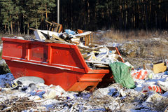 Garbage tank container rubbish in woods invasion. Bad Royalty Free Stock Photo