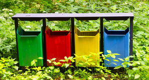 Garbage tanks. There are garbage bins, surrounded by plants Stock Image