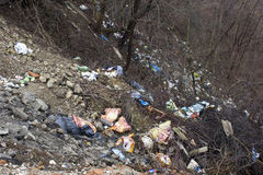 Garbage thrown in nature Royalty Free Stock Photography