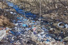 Garbage thrown to the bank of the river, the topic of environmental pollution royalty free stock photography