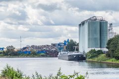 Garbage transhipment. Along the river in the Netherlands Royalty Free Stock Photo
